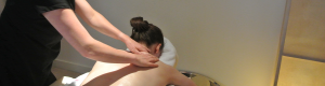 Anny from Glasgow Holistic Massage massaging Esther on the table